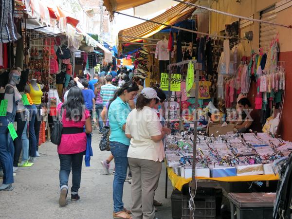 Caen a la mitad ventas en el comercio local