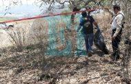 Hallan dos cuerpos momificados entre piedras, en un predio de Jacona